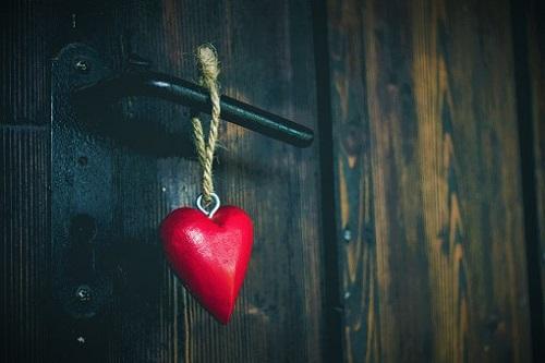 Close-Up Of Heart Shape Hanging To Door Handle